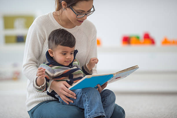Mother and Son Reading Together stock photo