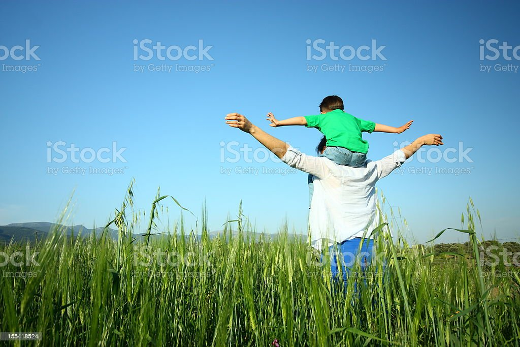Mother and son relaxing together outdoor stock photo