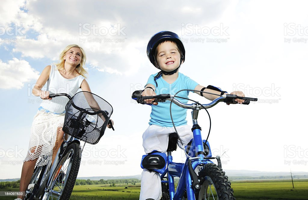 Mother and son riding bikes. royalty-free stock photo