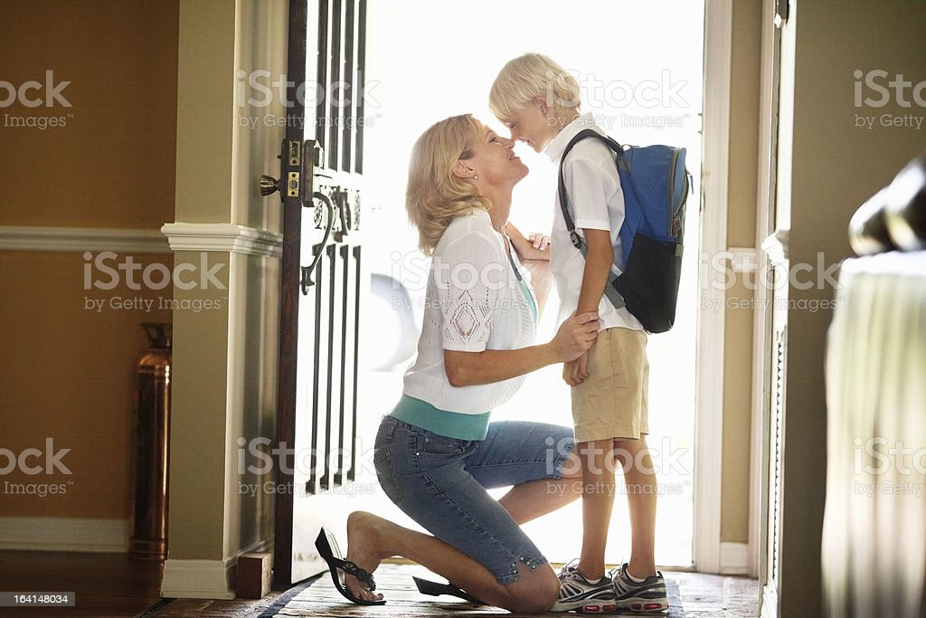 Mother And Son Rubbing Noses At Front Door stock photo