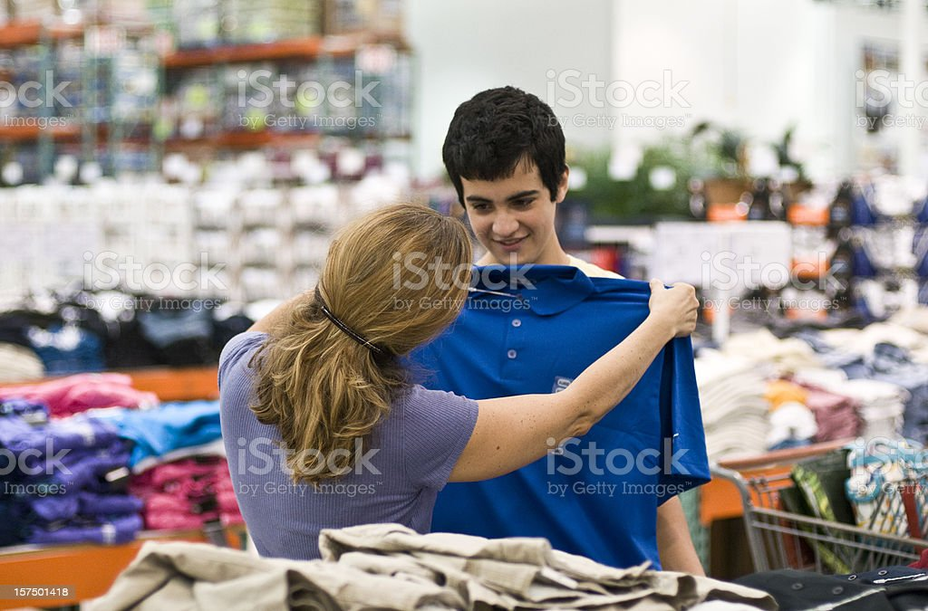 Mother and son shopping for clothes stock photo