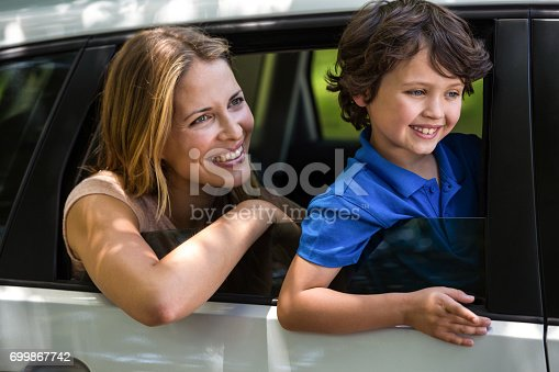 istock Mother and son sitting in a car 699867742
