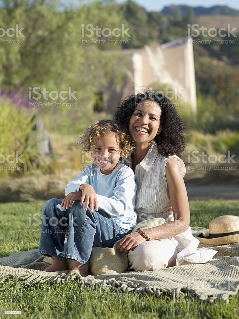 Mother and son sitting in park royalty-free stock photo