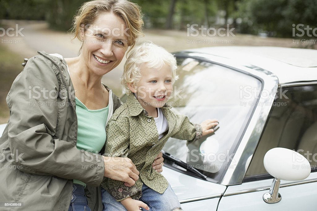 Mother and son sitting on car royalty-free stock photo