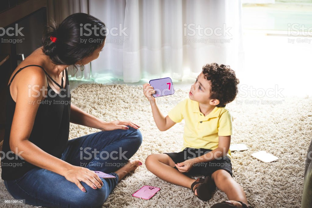 Mother and son sitting on the floor playing. royalty-free stock photo