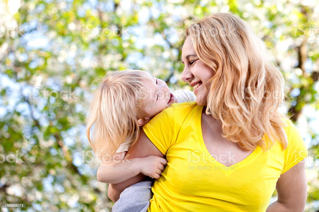 Mother and son smiling at each other royalty-free stock photo