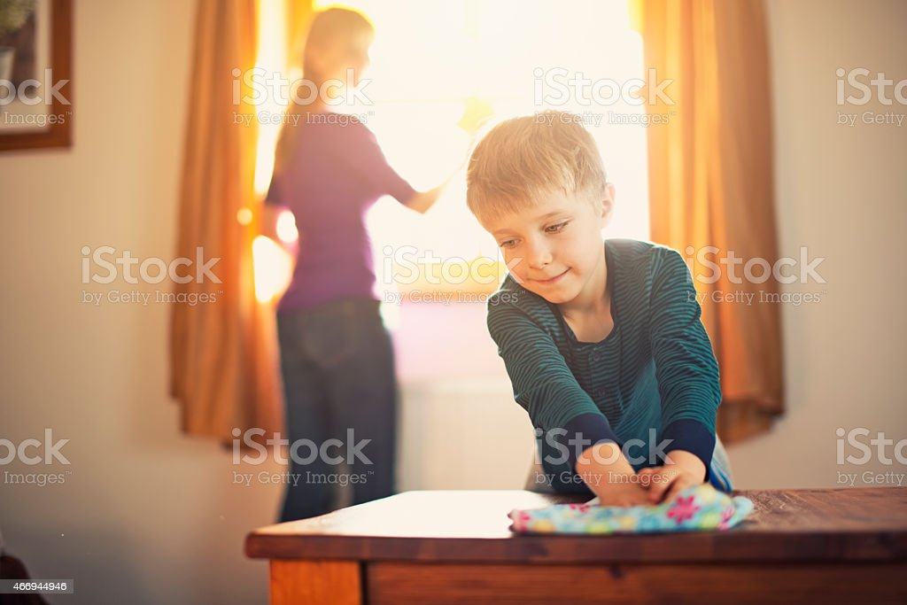 Mother and son spring cleaning stock photo