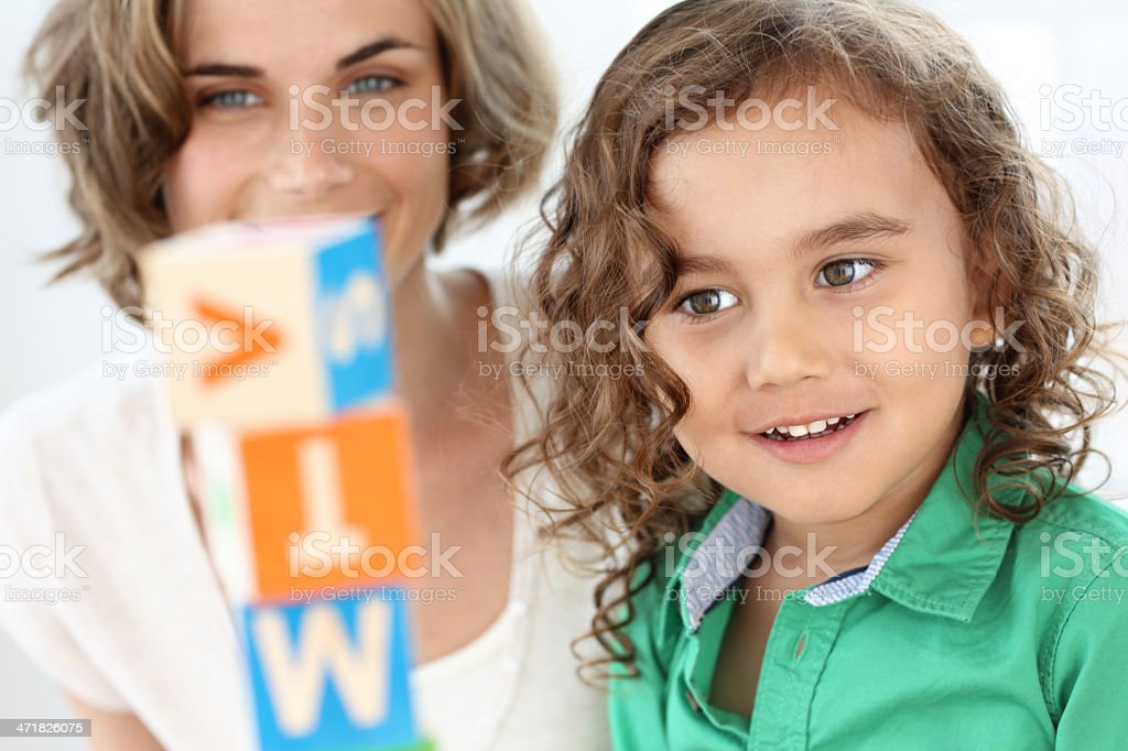 Mother and son stacking blocks together royalty-free stock photo