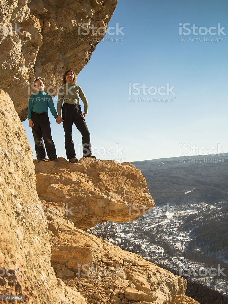 Mother and son standing at the cliff stock photo