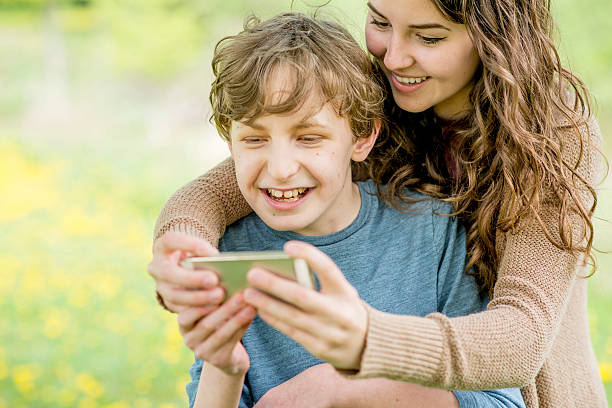 Mother and Son Taking a Selfie stock photo
