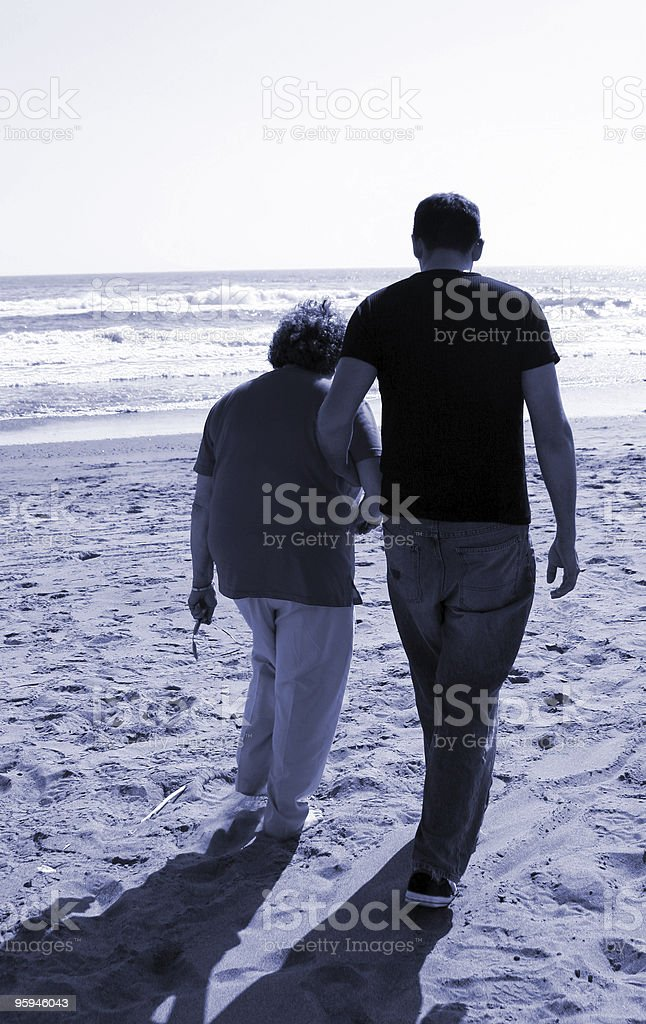 Mother and Son Taking a Walk on the Beach Family royalty-free stock photo