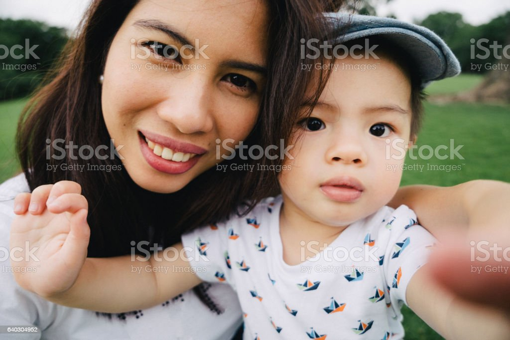 Mother and son taking selfie picture outdoors stock photo
