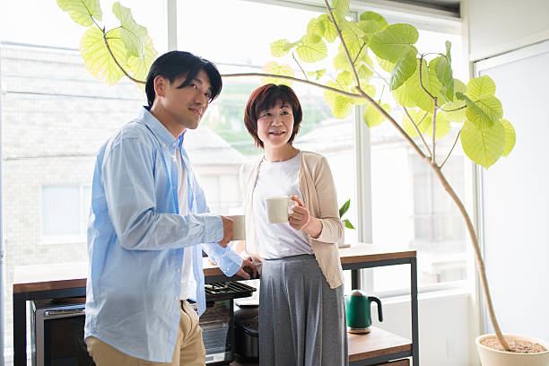 Mother and son talking Senior mother and mid adult son drinking coffee and bonding. Kyoto, Japan. May 2016 old mother son asian stock pictures, royalty-free photos & images