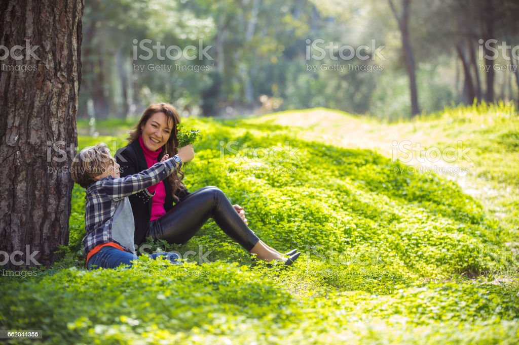 Mother and son tohetherness in green park royalty-free stock photo