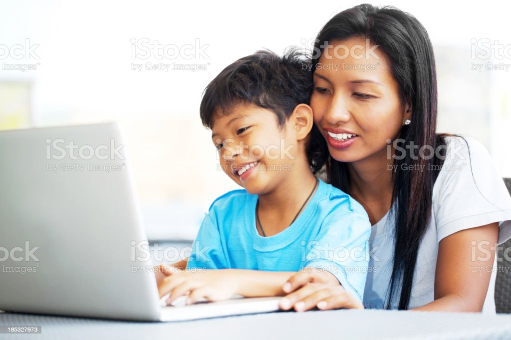 Mother and son using a computer royalty-free stock photo