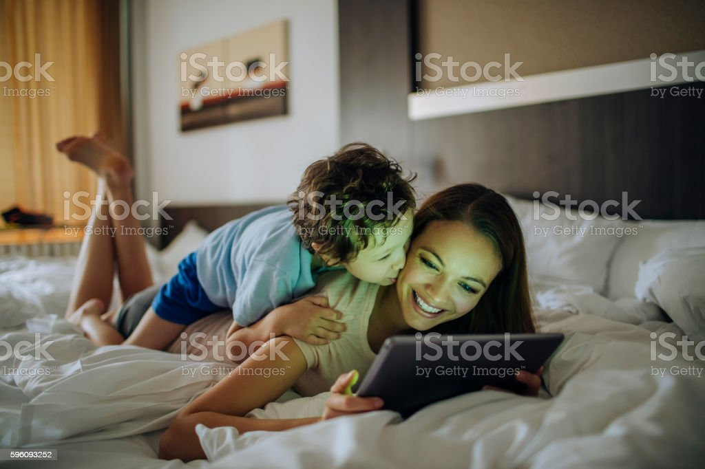 Mother and son using a digital tablet royalty-free stock photo