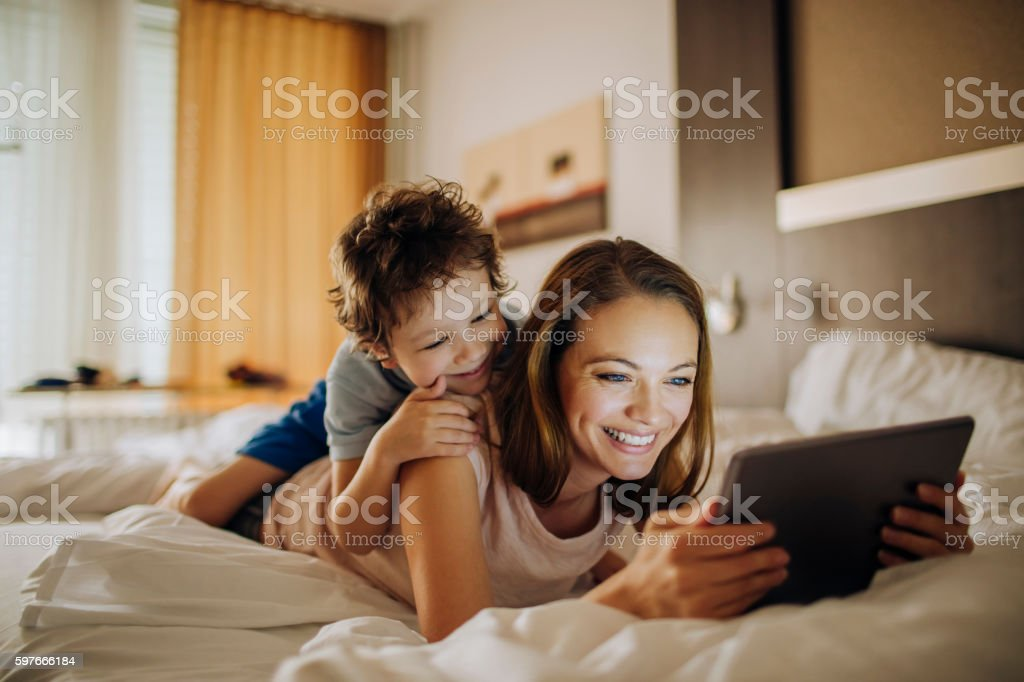 Mother and son using a digital tablet - Photo