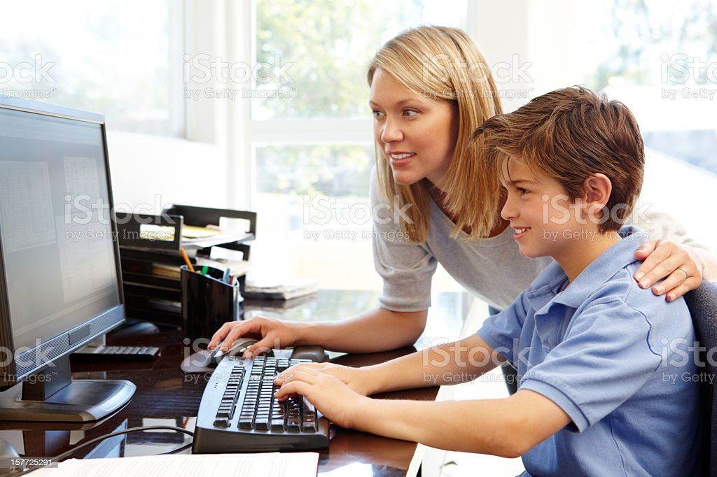 Mother and son using computer at home royalty-free stock photo