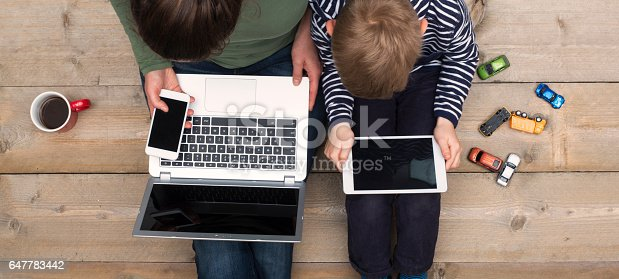 istock mother and son using digital media 647783442
