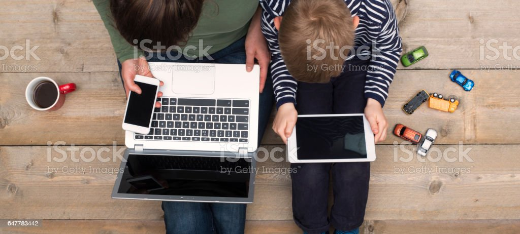 mother and son using digital media stock photo