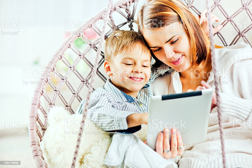 Mother and son using digital tablet royalty-free stock photo