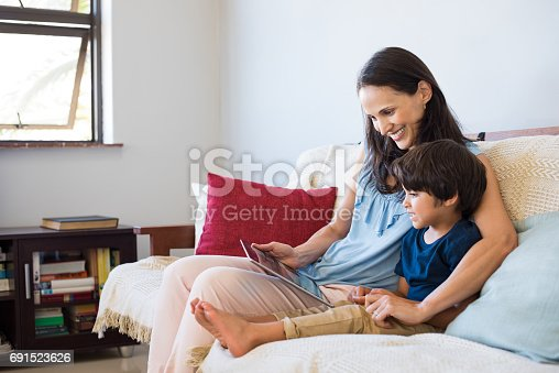 istock Mother and son using digital tablet 691523626