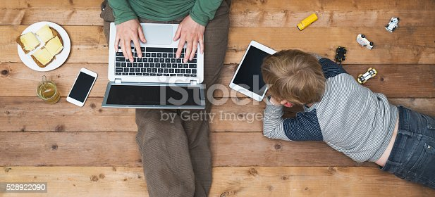 istock Mother and son using tablet and laptop 528922090