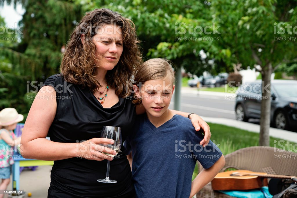 Mother and son waiting before show in family driveway. stock photo