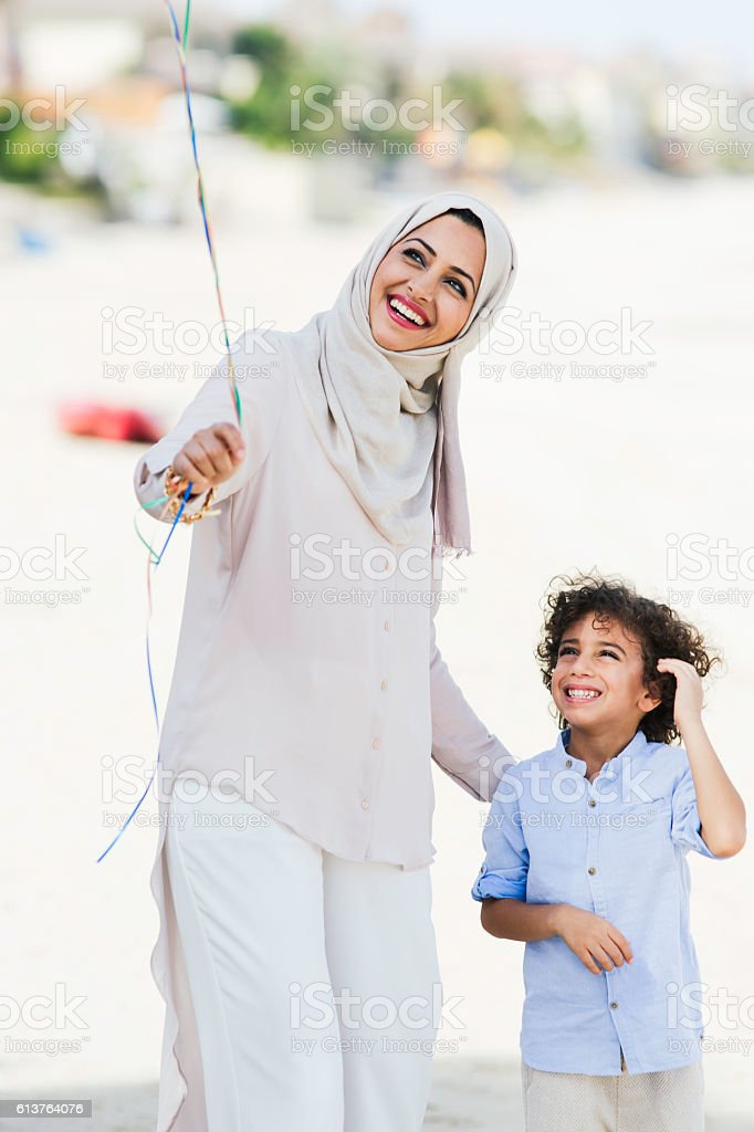 Mother and son walking in Dubai. stock photo