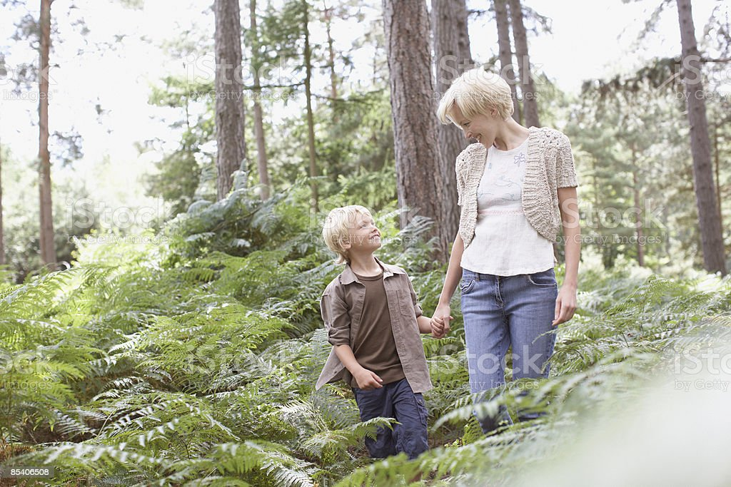 Mother and son walking in woods royalty-free stock photo