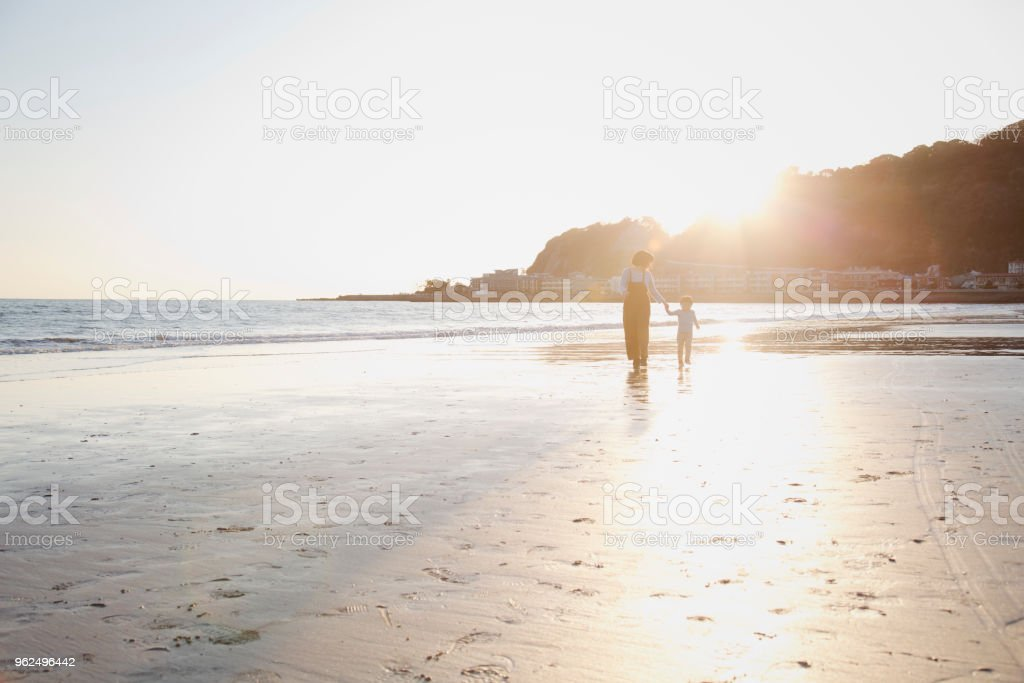 Mother and son walking on the beach together - Royalty-free 2-3 Years Stock Photo