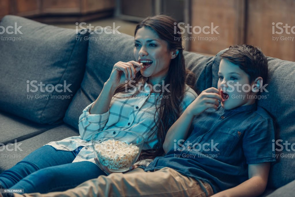Mother and son watching movie royalty-free stock photo