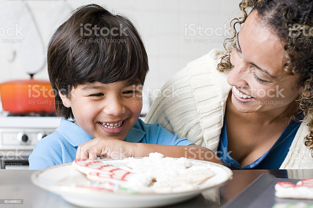 A mother and son with a plate of cookies royalty-free stock photo