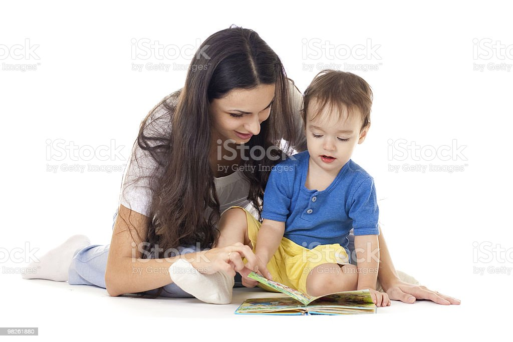 Mother and son with book together isolated on white royalty-free stock photo