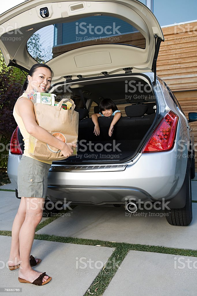 Mother and son with car and shopping stock photo