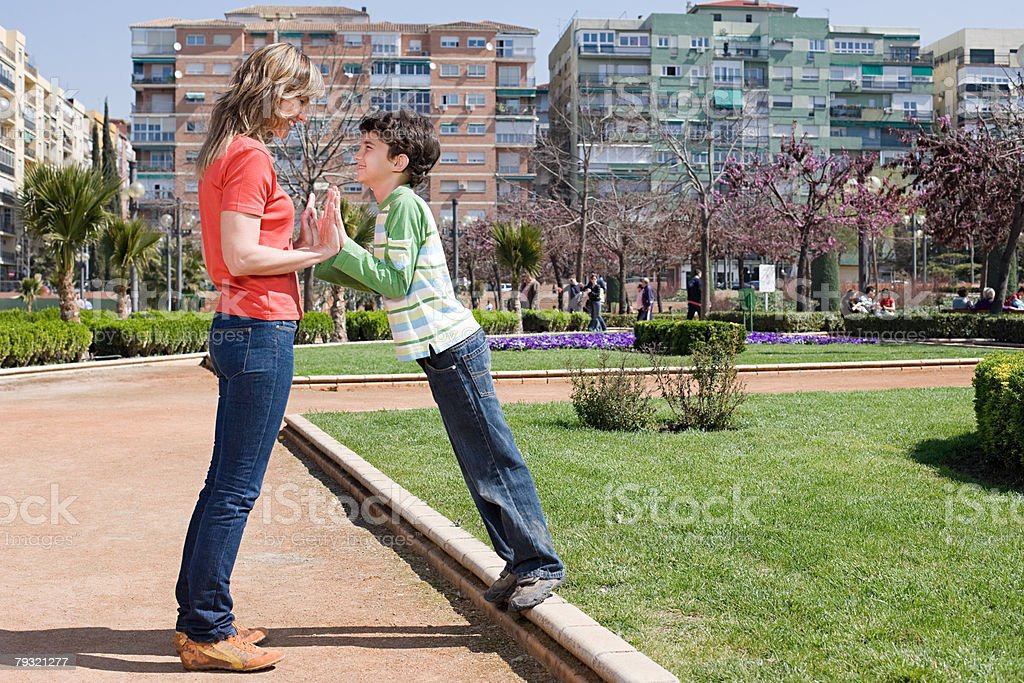 Mother and son with hands together royalty-free 스톡 사진