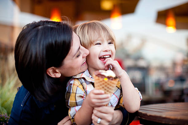 Mother and son with ice cream cone stock photo