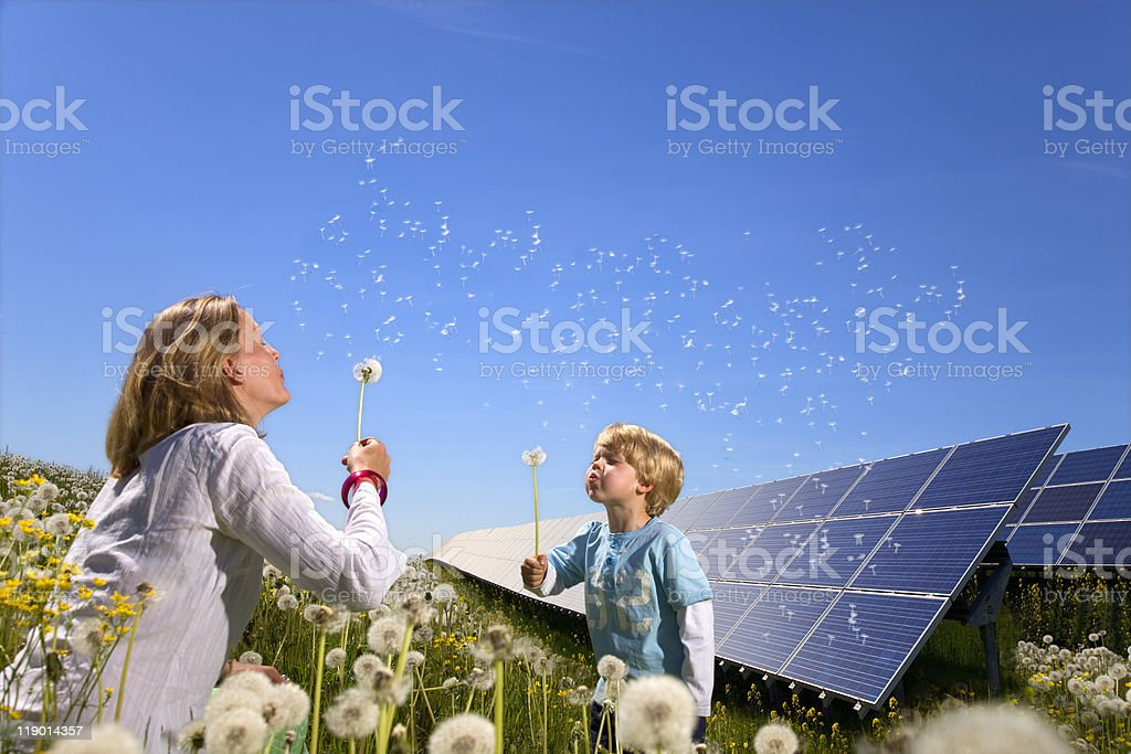 Mother and son with solar panels stock photo
