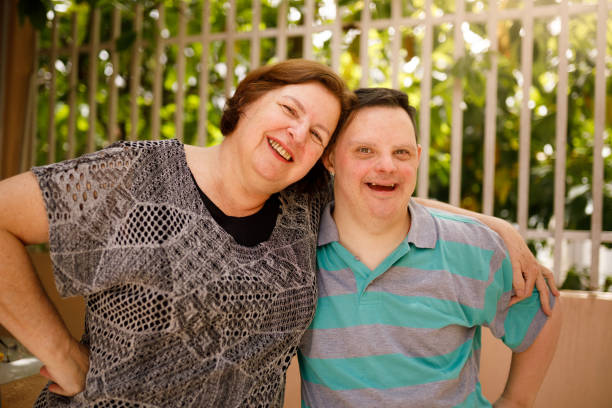 Mother and son with special needs bonding stock photo