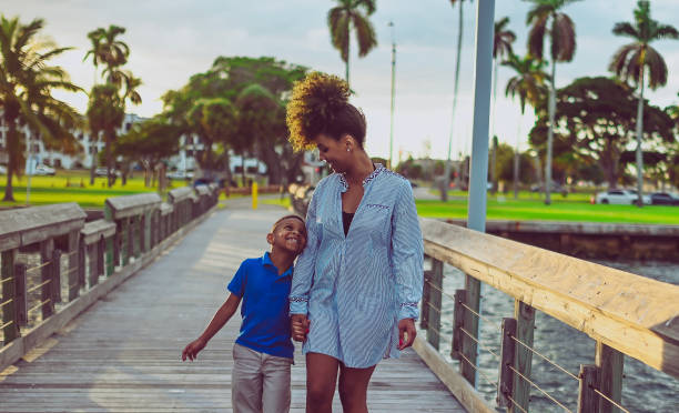 Mother and sun on the pier attractive african american family stock photo