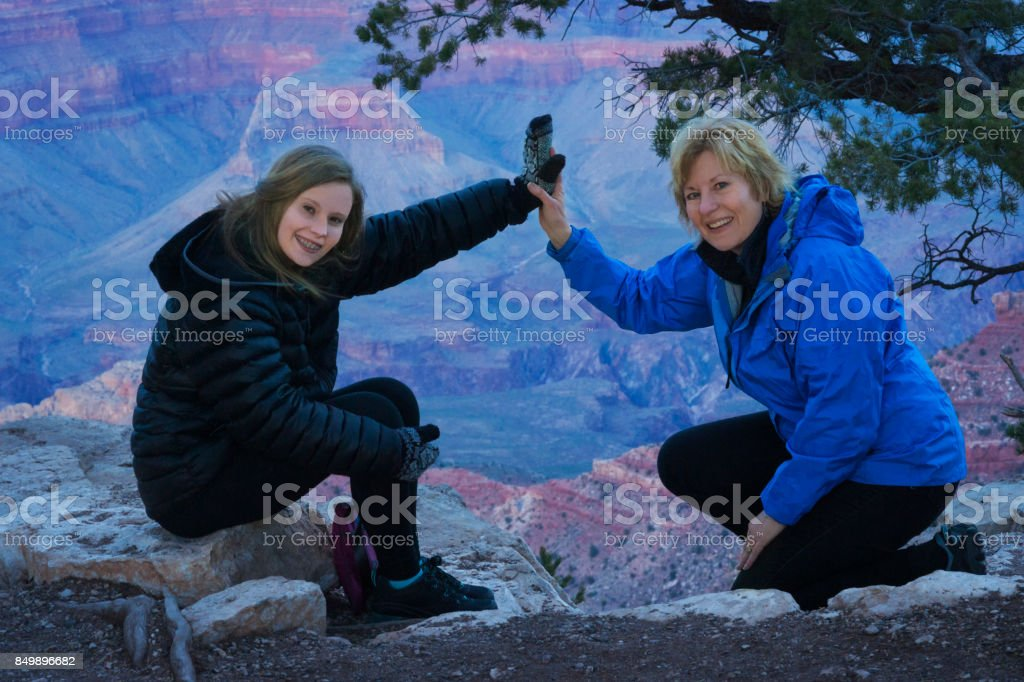 Mother and teen daughter at Grand Canyon stock photo