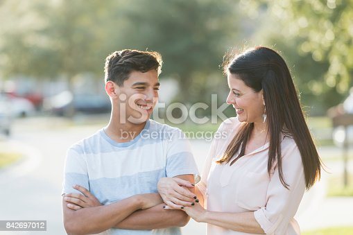 istock Mother and teenage son standing outdoors 842697012