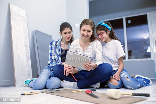 istock Mother and teenagers daughter works together 660468248
