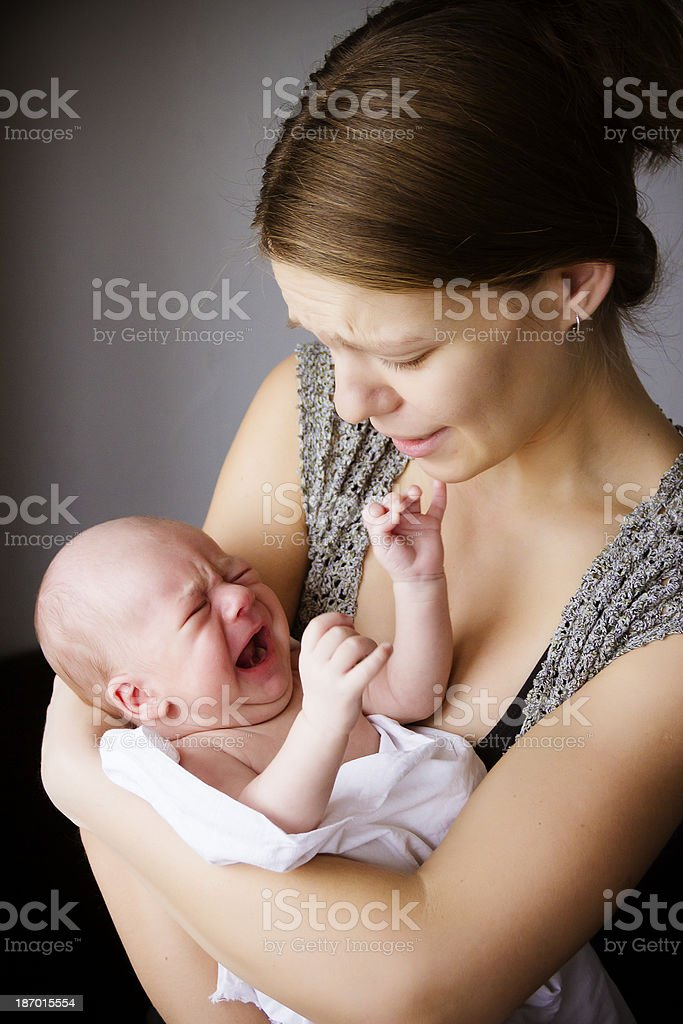 mother and the baby cry together royalty-free stock photo