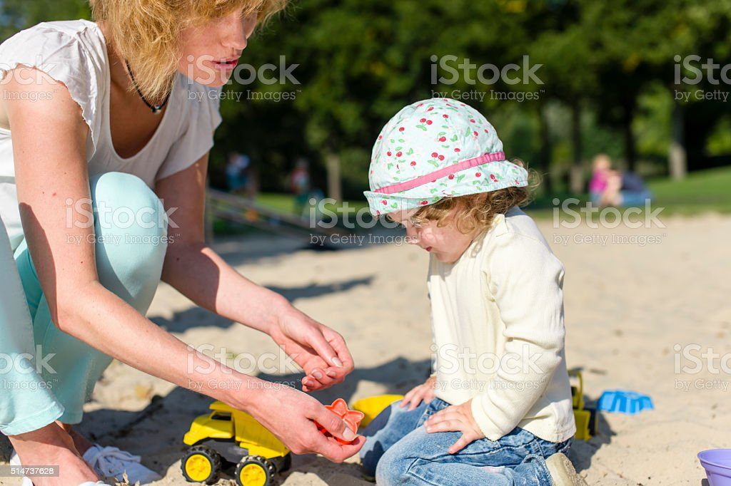Mother and toddler out together on the playground stock photo