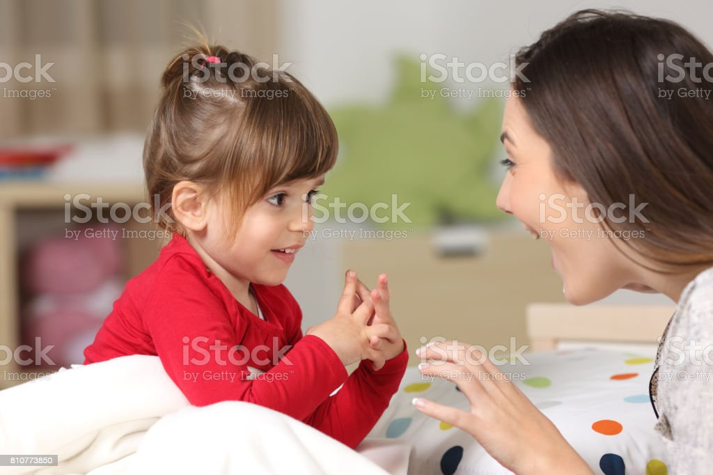 Mother and toddler playing together stock photo