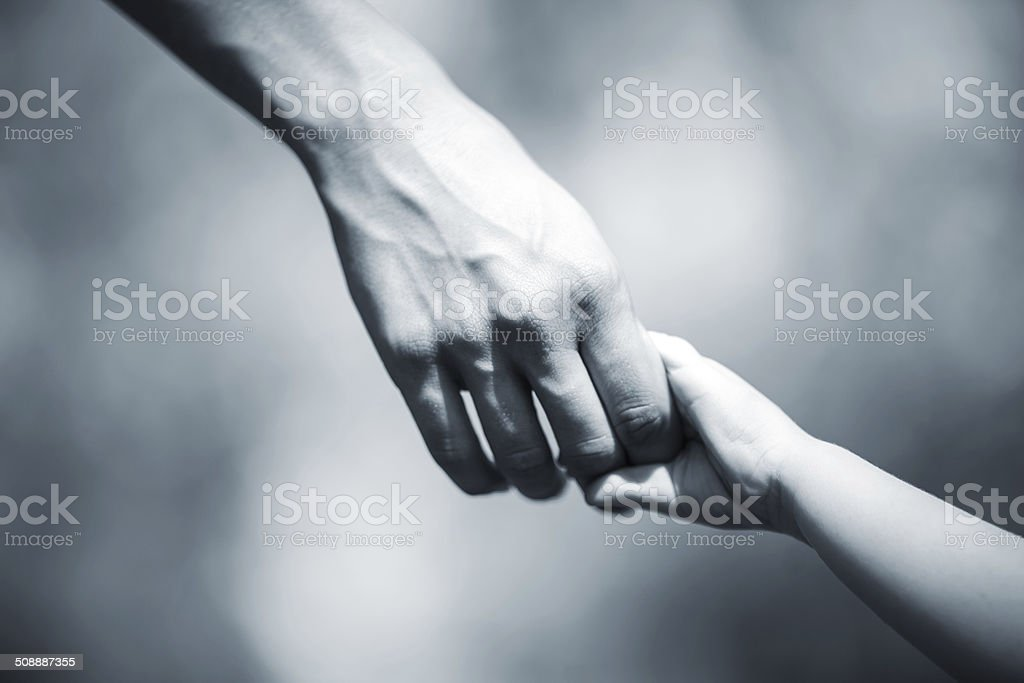 Mother and toddler walking stock photo