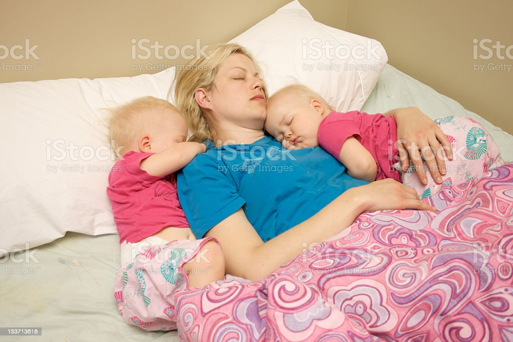 Mother and twins sleeping royalty-free stock photo