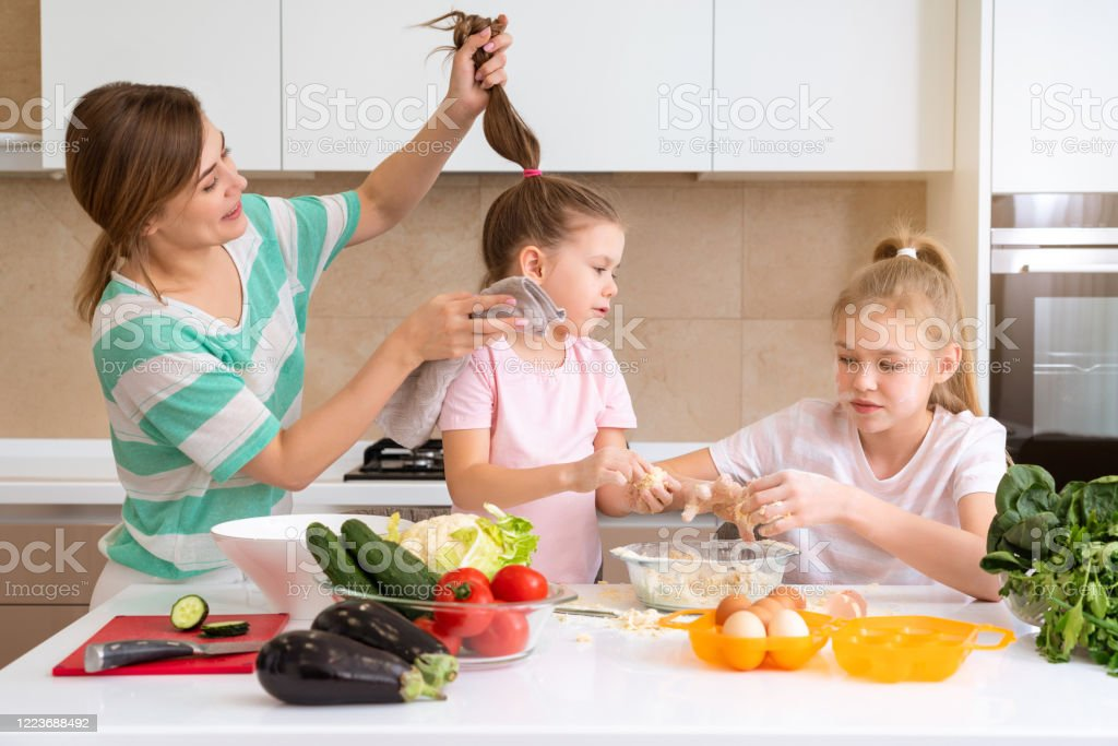 Mother And Two Daughters Cooking In The Kitchen And Having Fun Happy Family And Single Mother Concept Stock Photo Download Image Now Istock