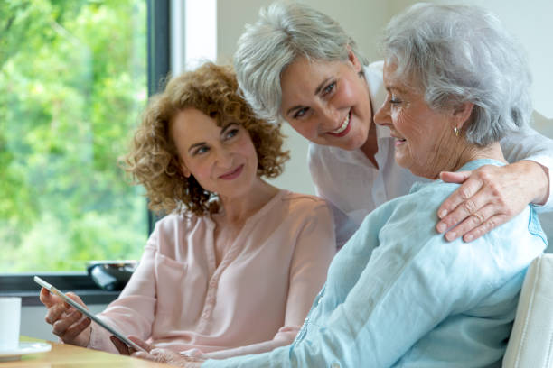 Mother and two daughters interaction stock photo